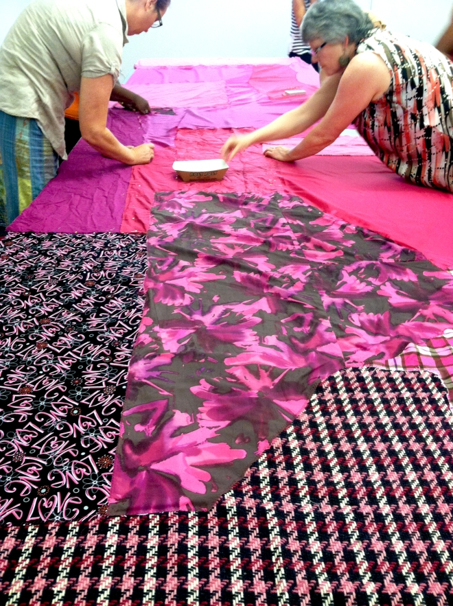 Sew-Op members Michelle Reynolds (left) and Shirley Hamilton (right) pin a segment of Magic Chromacity.